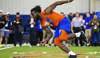 FILE - In this March 27, 2019, file photo, defensive lineman Jachai Polite runs drills during the University of Florida's football Pro Day in Gainesville, Fla. Polite is a possible pick in the 2019 NFL Draft. (Lauren Bacho/The Gainesville Sun via AP, File)