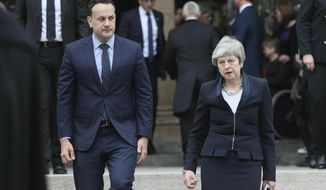 Britain's Prime Minister Theresa May, right and Ireland Prime Minister Leo Varadkar leave after the funeral service of journalist Lyra McKee, at St Anne's Cathedral in Belfast, northern Ireland, Wednesday April 24, 2019. The leaders of Britain and Ireland joined hundreds of mourners Wednesday at the funeral of Lyra McKee, the young journalist shot dead during rioting in Northern Ireland last week. (Brian Lawless/PA via AP)