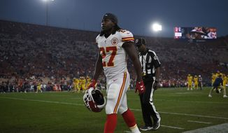 FILE - In this Nov. 19, 2018, file photo, Kansas City Chiefs running back Kareem Hunt walks on the sideline before an NFL football game against the Los Angeles Rams, in Los Angeles. Frank Clark will be making big bucks next season in the NFL. Kareem Hunt will get a shot at redemption. That video of Jeffery Simmons will be forgiven. So will Nick Bosa's tweets. Chances are, someone will find a way to employ Tyreek Hill. With the NFL _ and, really, everything in life _ it always comes down to the bottom line. And nothing's going to change until the fans say they've had enough, and actually mean it. (AP Photo/Kelvin Kuo, File)