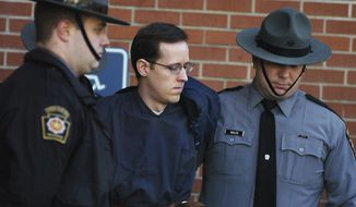 FILE - In this Jan. 5, 2015, file photo, Eric Frein is led away by Pennsylvania State Police Troopers at the Pike County Courthouse after his preliminary hearing in Milford, Pa. On Friday April 26, 2019, Pennsylvania's highest court uphold the death sentence and conviction of Frein who killed Pennsylvania state trooper Cpl. Bryon Dickson II and wounded another outside their barracks. (Butch Comegys/The Times-Tribune via AP, File)