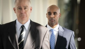 Former Minneapolis police officer Mohamed Noor walks through the skyway with his attorney Thomas Plunkett, left, on the way to court in Minneapolis on Friday, April 26, 2019. (Leila Navidi/Star Tribune via AP)