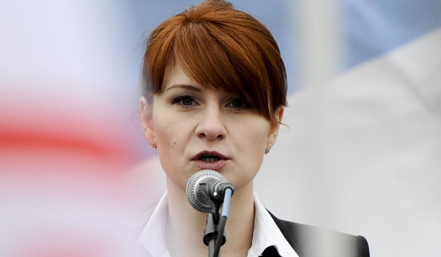 FILE - In this April 21, 2013 file photo, Maria Butina, leader of a pro-gun organization in Russia, speaks to a crowd during a rally in support of legalizing the possession of handguns in Moscow, Russia.  (AP Photo/File)