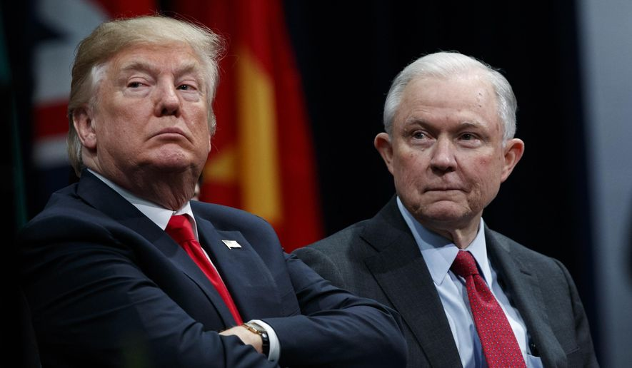 In this Dec. 15, 2017, file photo, President Donald Trump sits with then-Attorney General Jeff Sessions during the FBI National Academy graduation ceremony in Quantico, Va. (AP Photo/Evan Vucci) ** FILE **