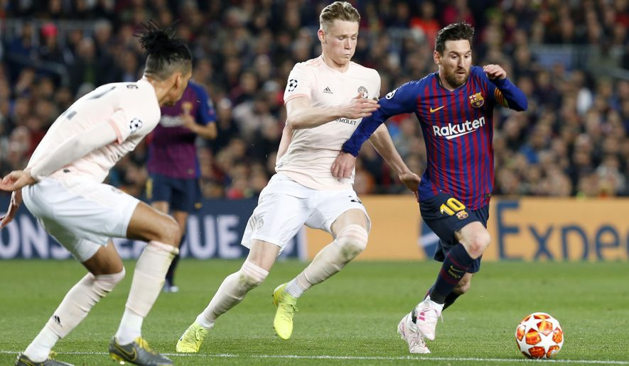 Barcelona forward Lionel Messi, right, runs with the ball past Manchester United's Scott McTominay, center, and Manchester United's Chris Smalling during the Champions League quarterfinal, second leg, soccer match between FC Barcelona and Manchester United at the Camp Nou stadium in Barcelona, Spain, Tuesday, April 16, 2019. (AP Photo/Joan Monfort)
