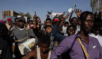 FILE - In this Monday, April 15, 2019 file photo, demonstraters rally near the military headquarters in Khartoum, Sudan. The Sudanese Professionals Association, SPA, an umbrella group of unions which led months of protests that eventually forced President Omar al-Bashir from power, says its revolution is far from over. The SPA says protesters will remain in the streets until the military hands power to a transitional civilian government. (AP Photo/Salih Basheer, File)