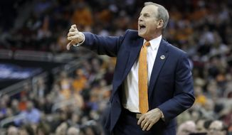 FILE -- In this March 28, 2019, file photo, Tennessee coach Rick Barnes calls a play during the first half of a men's NCAA tournament college basketball South Regional semifinal against Purdue in Louisville, Ky. Barnes believes he'd be settling in as UCLA's coach right about now if buyout negotiations hadn't broken down. (AP Photo/Michael Conroy, File)