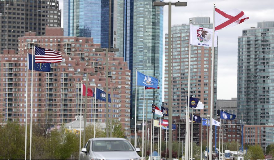 A United States flag, top left, flies near other state flags on the pole slated for the Mississippi state flag at Liberty State Park, Saturday, April 27, 2019, in Jersey City, N.J. On Friday, April 26, 2019, New Jersey Gov. Phil Murphy ordered the Mississippi flag removed from the display of each state's flag and replaced by the American flag because it has a confederate emblem on it. (AP Photo/Julio Cortez)