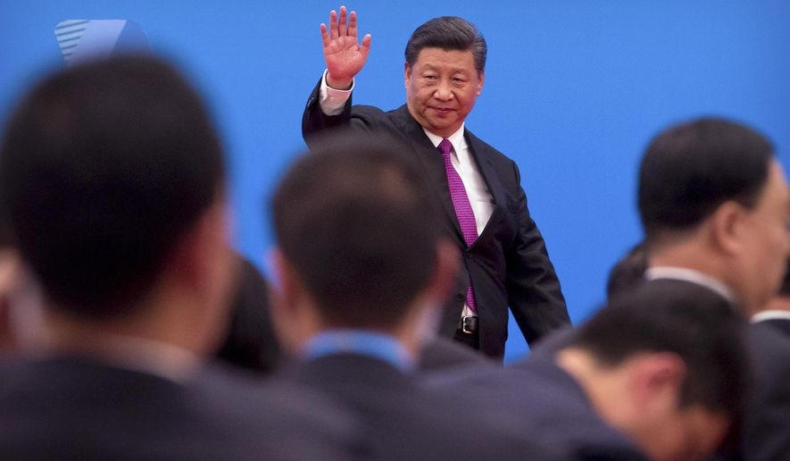 Chinese President Xi Jinping waves as he leaves after a press conference at the closing of the Belt and Road Forum at Yanqi Lake on the outskirts of Beijing, Saturday, April 27, 2019. Xi called Saturday for more countries to join China's sprawling infrastructure-building initiative in the face of U.S. opposition to a project Washington worries is increasing Beijing's strategic influence. (AP Photo/Mark Schiefelbein)