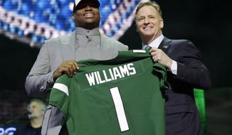 Alabama defensive tackle Quinnen Williams poses with NFL Commissioner Roger Goodell after the New York Jets selected Williams in the first round at the NFL football draft, Thursday, April 25, 2019, in Nashville, Tenn. (AP Photo/Mark Humphrey)