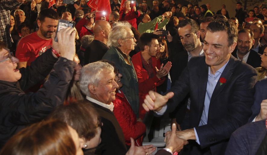 Spain's Prime Minister and Socialist Party candidate Pedro Sanchez greets to supporters during the closing campaign event in Valencia, Spain, Friday April 26, 2019. Appealing to Spain's large pool of undecided voters, top candidates on both the right and left are urging Spaniards to choose wisely and keep the far-right at bay in Sunday's general election. (AP Photo/Alberto Saiz)