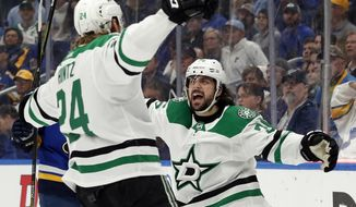 Dallas Stars' Roope Hintz, of Finland, is congratulated by Mats Zuccarello, right, after scoring during the first period in Game 2 of an NHL second-round hockey playoff series against the St. Louis Blues Saturday, April 27, 2019, in St. Louis. (AP Photo/Jeff Roberson)