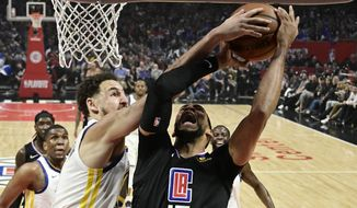 Los Angeles Clippers guard Garrett Temple, right, has his shot blocked by Golden State Warriors guard Klay Thompson during the first half in Game 6 of a first-round NBA basketball playoff series Friday, April 26, 2019, in Los Angeles. (AP Photo/Mark J. Terrill)