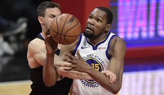 Golden State Warriors forward Kevin Durant, right, is fouled by Los Angeles Clippers forward Danilo Gallinari during the second half in Game 6 of a first-round NBA basketball playoff series Friday, April 26, 2019, in Los Angeles. The Warriors won 129-110. (AP Photo/Mark J. Terrill)