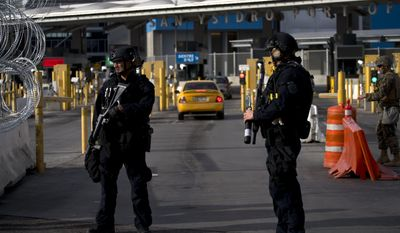 """U.S. Customs and Border Protection agents attend operational readiness exercises at the San Ysidro port of entry on the U.S.-Mexico border, seen from Tijuana, Mexico, Thursday, Nov. 22, 2018. U.S. President Donald Trump threatened Thursday to close the U.S. border with Mexico for an undisclosed period if his administration determines Mexico has lost """"control"""" on its side. (AP Photo/Ramon Espinosa)"""