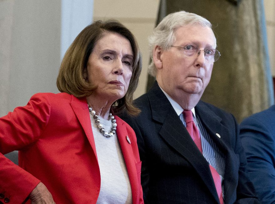 In this March 21, 2018, file photo Nancy Pelosi of Calif.,  and Senate Majority Leader Mitch McConnell of Ky., attend a Congressional Gold Medal Ceremony honoring the Office of Strategic Services in Emancipation Hall on Capitol Hill in Washington. Pelosi and McConnell are coming together to see if a deal can be made to stop billions of dollars in government spending cuts. Failure to reach an agreement would usher in cuts to the Pentagon and domestic programs of $125 billion next year _ a 10 percent drop from current levels.(AP Photo/Andrew Harnik, File)