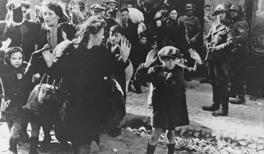 In this April 19, 1943, file photo, a group of Jews is escorted from the Warsaw Ghetto by German soldiers. After a year of tough negotiations, Germany agreed Monday, Dec. 5, 2011, to pay pensions to about 16,000 Holocaust victims worldwide who survived wartime ghettos or were forced to hide from Nazi persecution. (AP Photo, File)