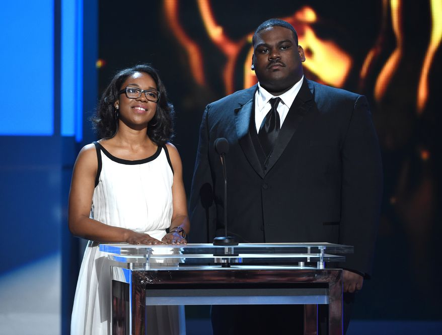 Valeska Gutierrez, left, and John Gaskin III present the Vanguard Award on stage at the 46th NAACP Image Awards at the Pasadena Civic Auditorium on Friday, Feb. 6, 2015, in Pasadena, Calif. (Photo by Chris Pizzello/Invision/AP)