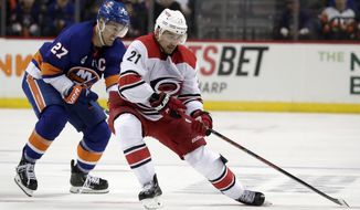 Carolina Hurricanes right wing Nino Niederreiter (21), of Switzerland, skates with the puck against New York Islanders' Anders Lee (27) during the third period of Game 2 of an NHL hockey second-round playoff series, Sunday, April 28, 2019, in New York. (AP Photo/Julio Cortez) ** FILE **