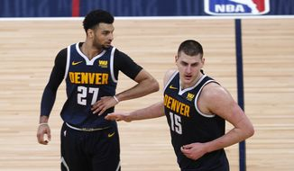 Denver Nuggets guard Jamal Murray, left, is congratulated after making a basket by center Nikola Jokic late in the second half of Game 7 of an NBA basketball first-round playoff series against the San Antonio Spurs, Saturday, April 27, 2019, in Denver. The Nuggets won 90-86 to advance to the second round against Portland. (AP Photo/David Zalubowski) **FILE**