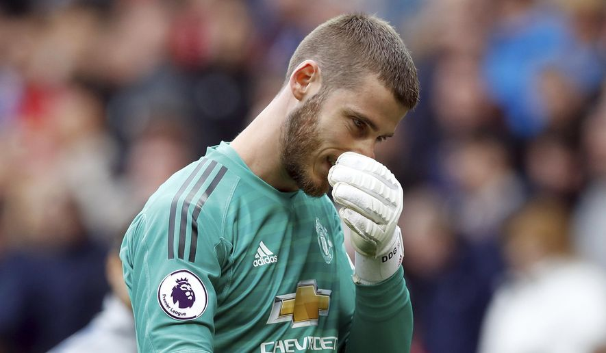 Manchester United goalkeeper David de Gea appears dejected after their English Premier League soccer match against Chelsea at Old Trafford, Manchester, England, Sunday, April 28, 2019. The game ended in a 1-1 draw. (Martin Rickett/PA via AP)