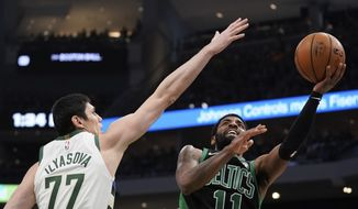 Boston Celtics' Kyrie Irving shoots past Milwaukee Bucks' Ersan Ilyasova during the second half of Game 1 of a second round NBA basketball playoff series Sunday, April 28, 2019, in Milwaukee. The Celtics won 112-90 to take a 1-0 lead in the series. (AP Photo/Morry Gash)