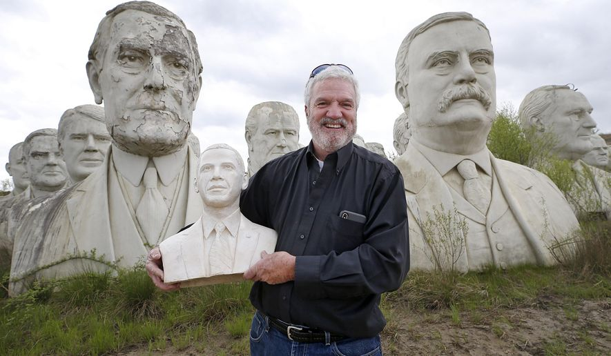 Howard Hankins holds a bust of former President Barack Obama  Friday, April 19, 2019 after it was returned to his Croaker, Va., farm. A Richmonder, who took the bust when joining the Presidents Heads Walking Tour led by photographer John Plashal, returned it.   (Alexa Welch Edlund/Richmond Times-Dispatch via AP)/Richmond Times-Dispatch via AP)