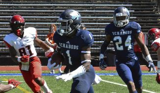 In this Sept. 22, 2018 photo, Washburn defensive back Corey Ballentine carries the ball during an NCAA college football game in Topeka, Kan. Police in Kansas are investigating a shooting that killed one current Washburn University football player and injured a former player just hours after he was drafted by the New York Giants. Topeka police say officers found 23-year-old defensive back Dwane Simmons dead when they investigated gunshots shortly before 1 a.m. Sunday, April 28, 2019. Ballentine is the wounded player who was picked by the Giants in the sixth round of the NFL draft Saturday. (Phil Anderson/Topeka Capital-Journal via AP) **FILE**