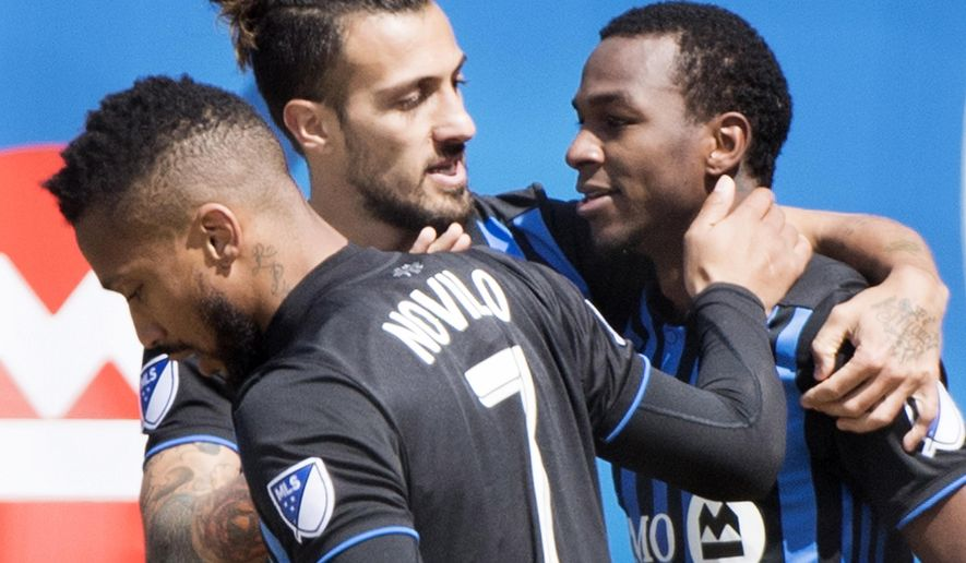 Montreal Impact's Omar Browne, right, celebrates with teammates Maximiliano Urruti, center, and Harry Novillo after scoring against the Chicago Fire during second-half MLS soccer match action in Montreal, Sunday, April 28, 2019. (Graham Hughes/The Canadian Press via AP)