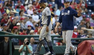 San Diego Padres shortstop Fernando Tatis Jr., front left, leaves a baseball game after being injured during the tenth inning of a baseball game against the Washington Nationals, Sunday, April 28, 2019, in Washington. (AP Photo/Nick Wass)