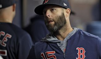 Boston Red Sox's Dustin Pedroia talks to a teammate before a baseball game against the Tampa Bay Rays, Friday, April 19, 2019, in St. Petersburg, Fla. Pedroia was placed on the 10-day disabled list after re-injuring his knee. (AP Photo/Chris O'Meara)