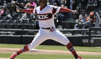 Chicago White Sox starting pitcher Reynaldo Lopez (40) throws against the Detroit Tigers during the first inning of a baseball game, Sunday, April 28, 2019, in Chicago. (AP Photo/David Banks)