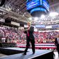 President Trump applauds his audience of 10,000 at a rally in Green Bay, Wisconsin. His energy and focus is beginning to worry Democrats. (Associated Press)