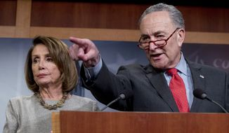 Senate Minority Leader Sen. Chuck Schumer of N.Y., accompanied by Speaker Nancy Pelosi of Calif., left, calls on a reporter during a news conference on Capitol Hill in Washington, Friday, Jan. 25, 2019, after President Donald Trump announces a deal to reopen the government for three weeks. (AP Photo/Andrew Harnik) ** FILE **