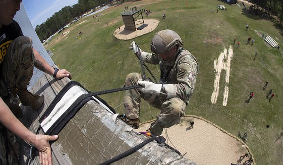 An Army Ranger rappels off a tower during the Day Stakes portion of the Best Ranger competition Saturday, April 13, 2019, at Fort Benning, Ga. (AP Photo/John Bazemore) **FILE**