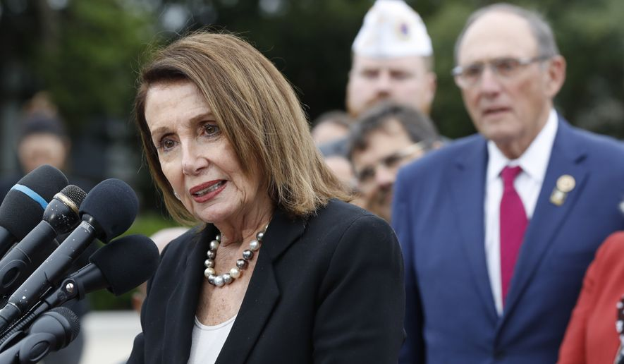 House Speaker Nancy Pelosi of Calif., left, speaks, with House Veterans' Affairs Ranking Member Phil Roe, R-Tenn., at right, during a news conference about veteran suicide prevention, Monday April 29, 2019, at the House Triangle on Capitol Hill in Washington. (AP Photo/Jacquelyn Martin)