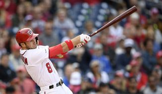 Washington Nationals' Carter Kieboom bats during a baseball game against the San Diego Padres, Saturday, April 27, 2019, in Washington. The Padres won 8-3 in ten innings. (AP Photo/Nick Wass)