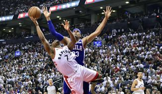 Toronto Raptors guard Kyle Lowry (7) draws a foul on Philadelphia 76ers forward Tobias Harris (33) as he drives to the net during second-half, second-round NBA basketball playoff action in Toronto, Monday, April 29, 2019. (Frank Gunn/The Canadian Press via AP)
