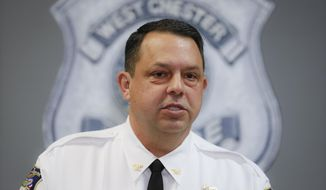West Chester Chief of Police Joel Herzog speaks to reporters during a news conference, Monday, April 29, 2019, in West Chester, Ohio. Multiple people were found dead at an apartment complex in Ohio after a man called 911 saying he had returned home to find his wife and family members on the ground and bleeding. Herzog said that police were searching the area for any suspect, and there was no immediate threat to the community.  (AP Photo/John Minchillo)