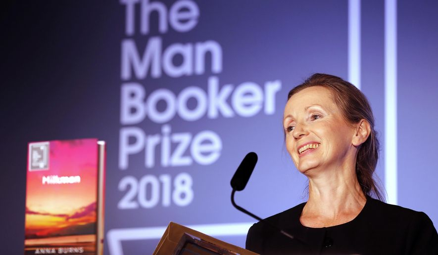 "FILE - In this Oct. 16, 2018 file photo, author Anna Burns smiles after being presented with the Man Booker Prize for Fiction 2018 for ""Milkman,"" during the prize's 50th year at the Guildhall in London. Nigerian debut novelist Oyinkan Braithwaite and U.K. Booker Prize winner Anna Burns are among six finalists for the international Women's Prize for Fiction. (AP Photo/Frank Augstein, File)"