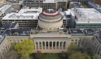 """This Sunday, April 28, 2019, photo provided by Raymond Huffman shows Massachusetts Institute of Technology's signature Great Dome draped with a giant cloth version of Captain America's red, white and blue shield, in Cambridge, Mass. MIT students for generations have centered similar pranks on the dome, this time drawing inspiration from America's hottest movie, """"Avengers: Endgame."""" The shield went up Saturday night and was taken down Monday morning. (Raymond Huffman via AP)"""