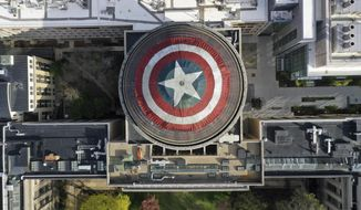 "This Sunday, April 28, 2019 photo provided by Raymond Huffman shows Massachusetts Institute of Technology's signature Great Dome draped with a giant cloth version of Captain America's red, white and blue shield, in Cambridge, Mass. MIT students for generations have centered similar pranks on the dome, this time drawing inspiration from America's hottest movie, ""Avengers: Endgame."" The shield went up Saturday night and was taken down Monday morning. (Raymond Huffman via AP)"