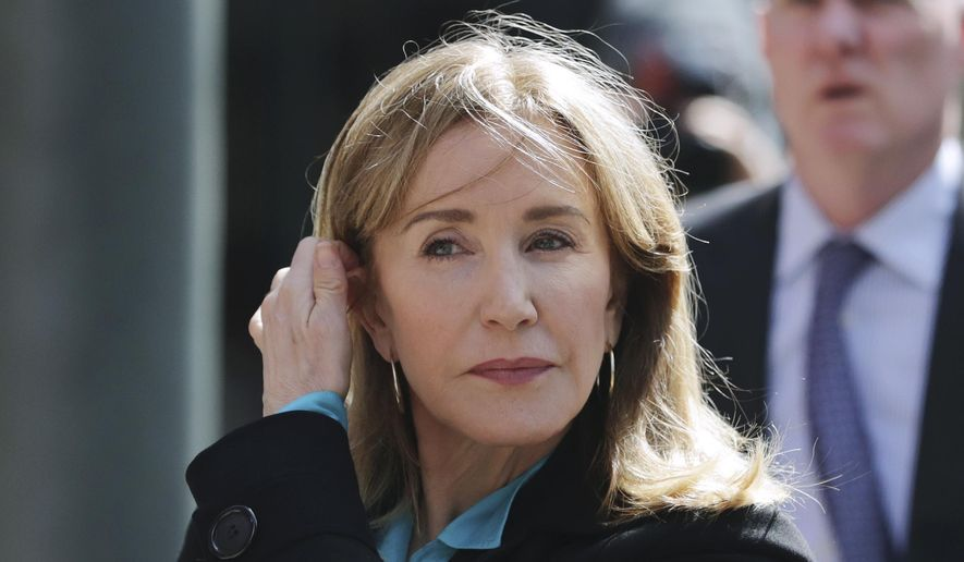 In this April 3, 2019, file photo, actress Felicity Huffman arrives at federal court in Boston to face charges in a nationwide college admissions bribery scandal. Huffman will plead guilty on May 13 to charges that she took part in the cheating scam. She had been scheduled to enter her plea on May 21, but a judge agreed to move up the hearing because the lead prosecutor will be out of town. (AP Photo/Charles Krupa, File)