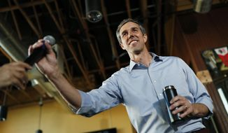 Democratic presidential candidate and former Texas congressman Beto O'Rourke is handed a microphone while speaking during a campaign stop Friday, April 26, 2019, in Henderson, Nev. (AP Photo/John Locher)
