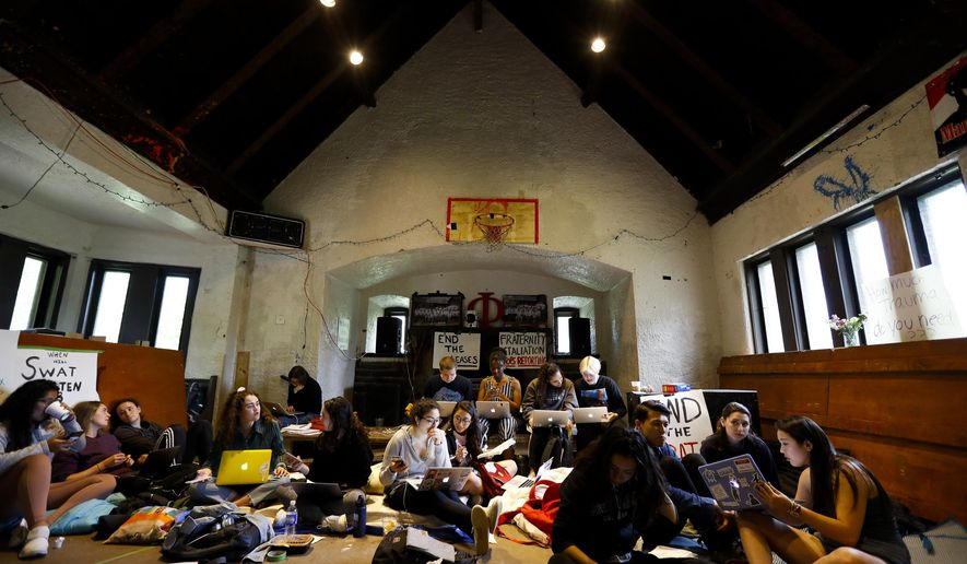 Swarthmore College students gather at the Phi Psi fraternity house during a sit-in, Monday, April 29, 2019, in Swarthmore, Pa. Students at the suburban Philadelphia college have occupied the on-campus fraternity house in an effort to get it shut down after documents allegedly belonging to Phi Psi surfaced this month containing derogatory comments about women and the LGBTQ community and jokes about sexual assault. (AP Photo)