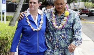 FILE - In this Oct. 20, 2017 file photo, former Honolulu Police Chief Louis Kealoha and his wife Katherine Keahola leave federal court in Honolulu. Kealoha was Honolulu's Rolex-wearing police chief and his wife Katherine was the Maserati-driving prosecutor in charge of a unit targeting career criminals. Prosecutors say the couple funded a lavish lifestyle by defrauding banks, relatives and children. They're heading to trial in May 2019 on charges they orchestrated the framing of a relative for a mailbox theft who threatened to expose their fraud.  (AP Photo/Caleb Jones, File)