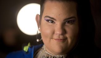 FILE - In this Jan. 29, 2019, file photo, Israeli singer Netta Barzilai, who won the 2018 Eurovision song contest, poses for a photo during an interview with the Associated Press in Tel Aviv, Israel. Barzilai says there is no place for boycott calls of this year's competition in Tel Aviv. (AP Photo/Sebastian Scheiner, File)