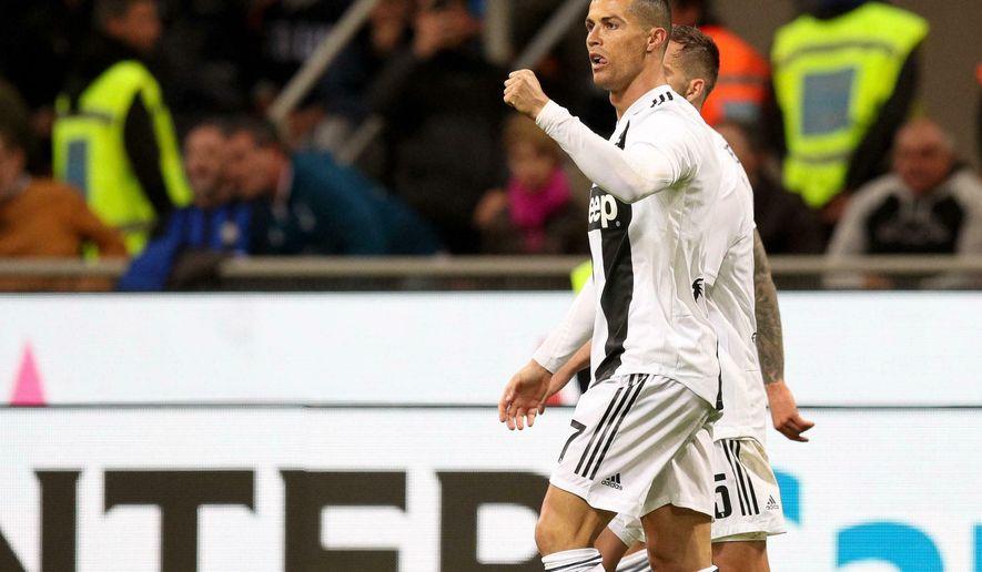 Juventus' Cristiano Ronaldo celebrates after scoring his side's first goal during the Serie A soccer match between Inter Milan and Juventus at the San Siro Stadium, in Milan, Italy, Saturday, April 27, 2019. (Roberto Bregani/ANSA via AP)
