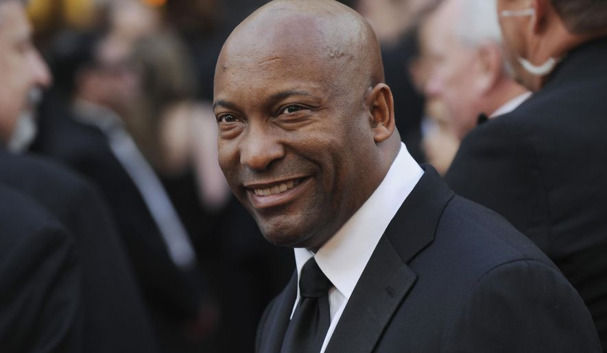 FILE - In this Feb. 24, 2008 file photo, director John Singleton arrives at the 80th Academy Awards in Los Angeles. Oscar-nominated filmmaker John Singleton has died at 51, according to statement from his family, Monday, April 29, 2019. He died Monday after suffering a stroke almost two weeks ago.  (AP Photo/Chris Pizzello, File)