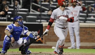 Cincinnati Reds' Jesse Winker, front right, watches his home run during the ninth inning of a baseball game against the New York Mets, Monday, April 29, 2019, in New York. (AP Photo/Frank Franklin II)