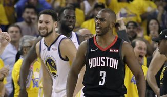 Golden State Warriors guard Klay Thompson, left, smiles as Houston Rockets guard Chris Paul (3) is ejected during the second half of Game 1 of a second-round NBA basketball playoff series in Oakland, Calif., Sunday, April 28, 2019. (AP Photo/Jeff Chiu) **FILE**